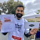 Teja is a BIG  Stanford Ophthalmology Lookin' for a Cure 5K lottery winner