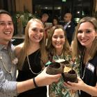 Gabe, Kellie, MaryAnn, and Katie coconut toast at the 2017 Byer's Eye Institute Holiday Party